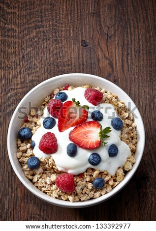 bowl of muesli and yogurt with fresh berries - stock photo