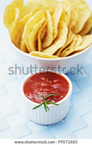 bowl of nachos with salsa with shallow DOF - stock photo