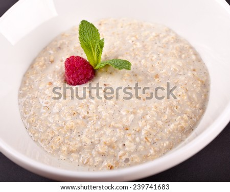Bowl of oats porridge - stock photo