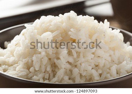 Bowl of Organic White Rice with chop sticks - stock photo