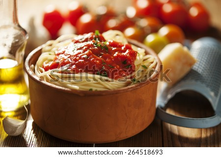 bowl of pasta with tomato sauce - stock photo