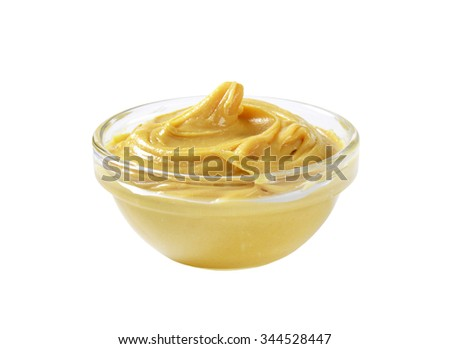 Bowl of peanut butter isolated on white - stock photo