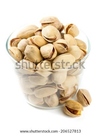 bowl of pistachio isolated on white - stock photo