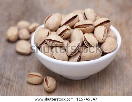 Bowl of pistachios - stock photo