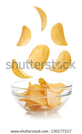 Bowl of potato chips isolated on a white - stock photo