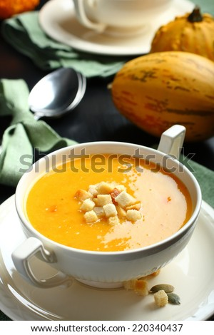 Bowl of pumpkin soup with bread crouton - stock photo