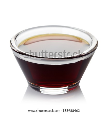 Bowl of soy sauce isolated on white background - stock photo