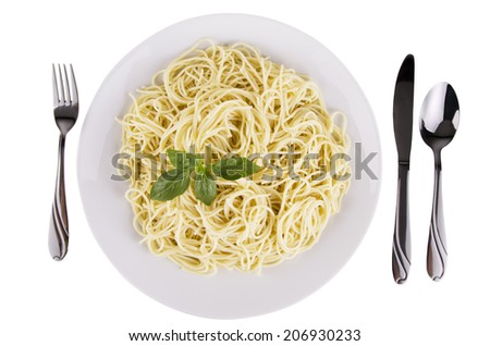 Bowl of spaghetti and basil leaves, isolated on white background. Top view. - stock photo