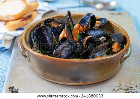 Bowl of steamed mussels - stock photo