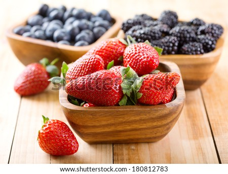 bowl of strawberry on wooden table - stock photo
