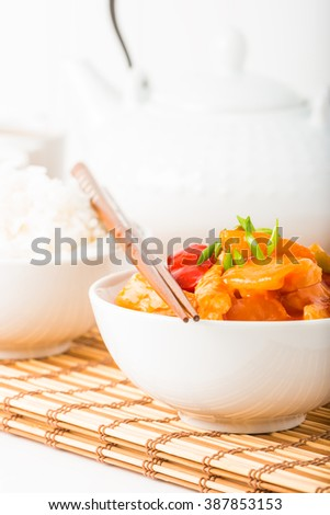 Bowl of sweet and sour chicken photographed closeup.  Useful for menus and other food service applications. - stock photo