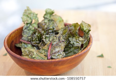 Bowl of swiss chard chips with Olive oil and sea salt - stock photo
