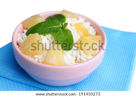 Bowl of tasty cottage cheese with pineapple, close up - stock photo