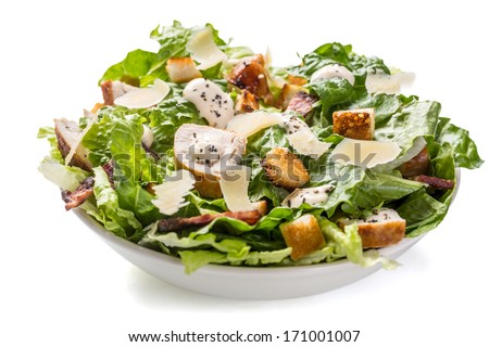 Bowl of Traditional Caesar Salad with Chicken and Bacon isolated on White Background - stock photo