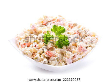 bowl of traditional russian salad on white background - stock photo