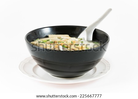 Bowl of Vietnamese noodle soup served with onions and cilantro,pho bo. - stock photo