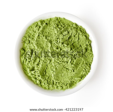 Bowl of wheat or barley grass powder isolated on white background, top view - stock photo