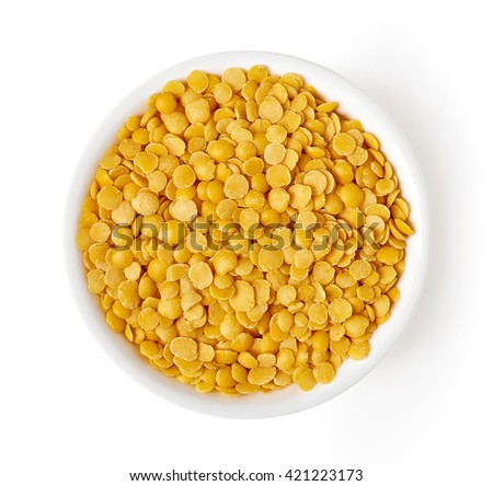 Bowl of yellow split lentil isolated on white background, top view - stock photo