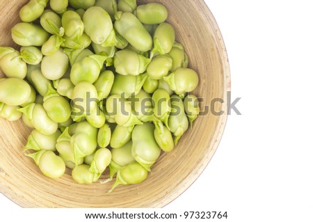 Bowl of young, fresh and tender broad beans on white. - stock photo