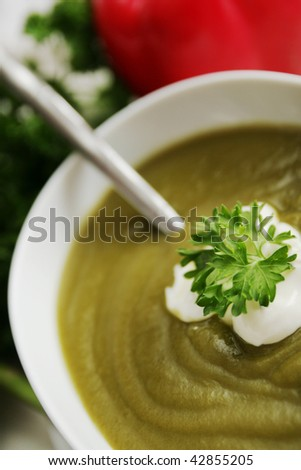 Bowl with asparagus or broccoli soup - stock photo
