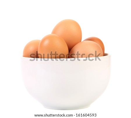 Bowl with brown eggs. Isolated on a white background - stock photo