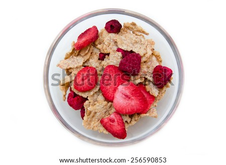 Bowl with cereals and fruits on white background top view - stock photo