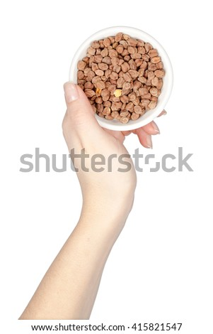 bowl with chickpeas in a hand isolated on white background. legumes - stock photo