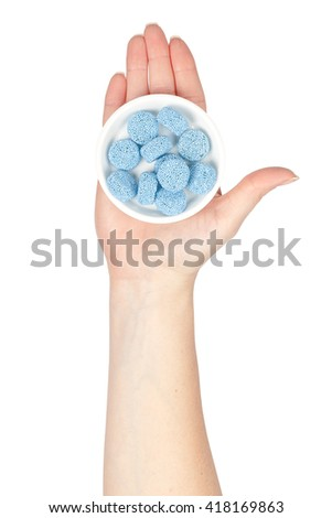 bowl with jelly candies in a hand isolated on white background. confectionery - stock photo