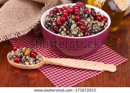 Bowl with kutia -  traditional Christmas sweet meal in Ukraine, Belarus and Poland, on wooden background - stock photo