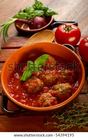 bowl with meatballs and tomato sauce - stock photo