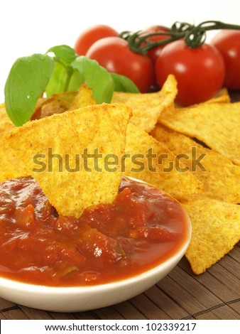 Bowl with mexican salsa and spicy nachos - stock photo