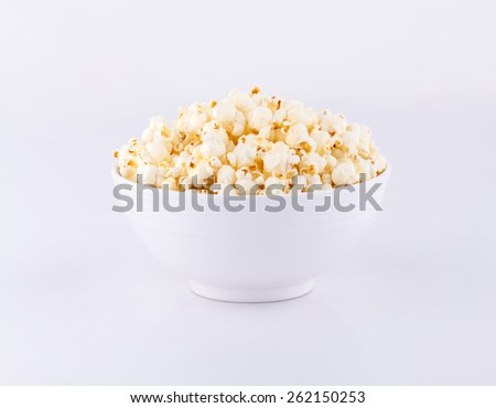 Bowl with popcorn isolated on white background  - stock photo
