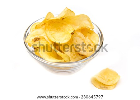 Bowl with potato chips on white background - stock photo