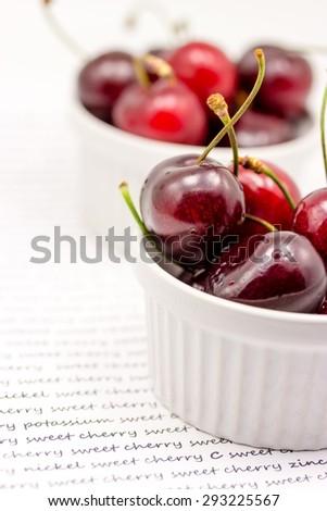 Bowl with ripe cherries - stock photo