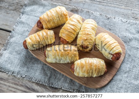 Bowl with sausage rolls - stock photo