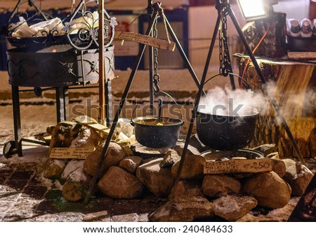 Bowlers with hot wine and soup at during Christmas night - stock photo