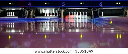 Bowling Pins and Ball in motion - stock photo