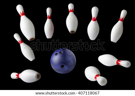 bowling pins and ball isolated on black background - stock photo