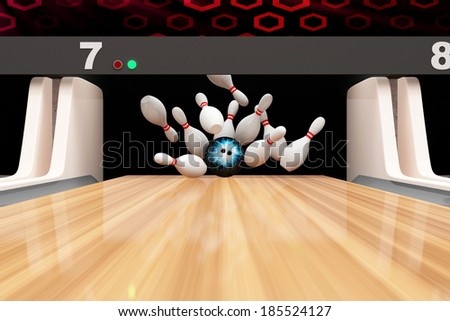Bowling Strike. Bowling Ball crashing into the Pins on Wooden Lane - stock photo