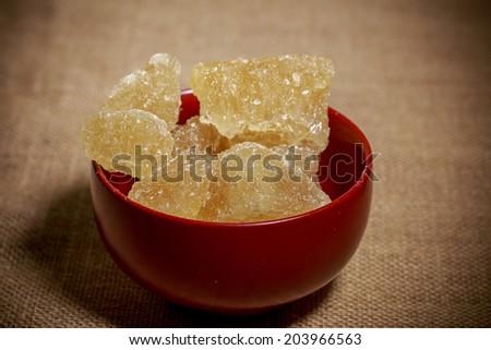 Bowlof brown rock sugar - stock photo