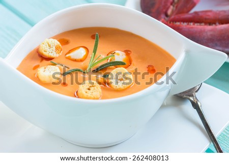 Bowls of lobster bisque with croutons - stock photo