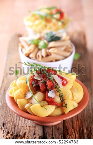 Bowls of various types of pasta - stock photo