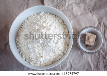 Bowls with flour and yeast. - stock photo