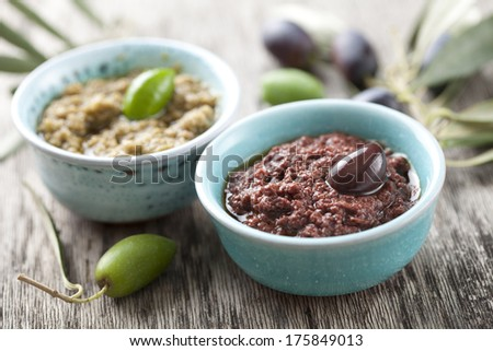 bowls with fresh olive paste made from kalamata olives - stock photo