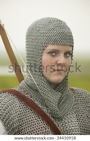 bows woman / medieval armor / historical story - stock photo