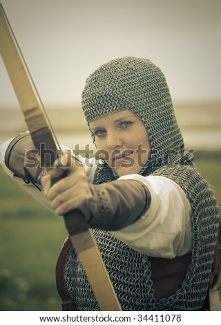bows woman / medieval armor / historical story  / retro split toned - stock photo