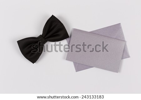 Bowtie and Blank Invitation Card - stock photo