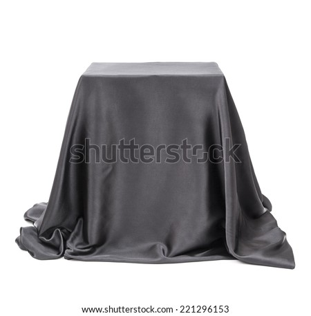 Box covered with black cloth.  - stock photo