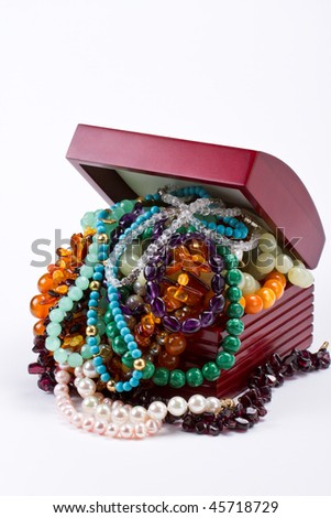 box full of colorful necklaces and bracelets - stock photo