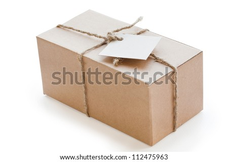 box of brown cardboard, tied with string and with blank label - stock photo